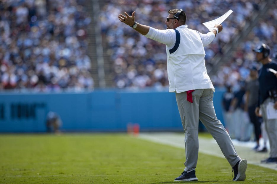 Tennessee Titans head coach Mike Vrabel gestures toward referees during the first half of an NF ...
