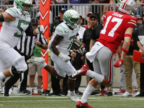 Oregon running back CJ Verdell, center, scores a touchdown against Ohio State during the first ...