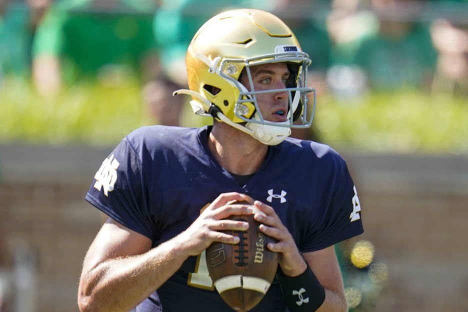 Notre Dame quarterback Jack Coan (17) throws against Purdue during the first half of an NCAA co ...