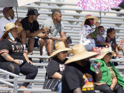 Cheyenne fans attempt to stay cool in 100-degree weather during a football game against Clark H ...