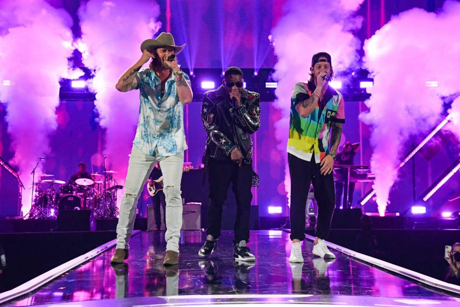 Nelly (C) performs with (L-R) Brian Kelley and Tyler Hubbard of Florida Georgia Line onstage du ...