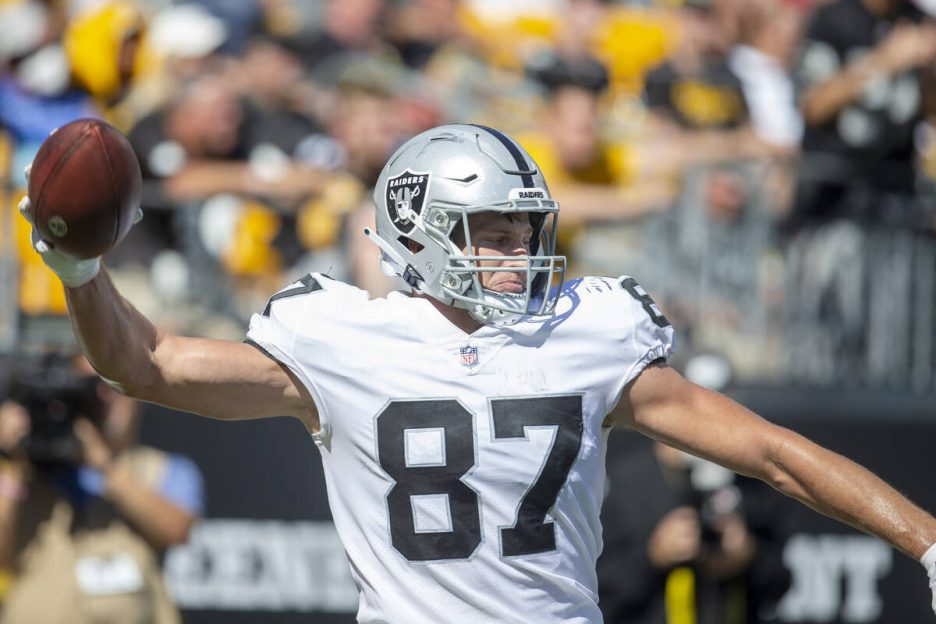 Raiders tight end Foster Moreau (87) prepares to spike the football after scoring a touchdown d ...