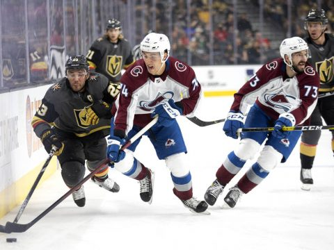 Golden Knights defenseman Alec Martinez (23) and Avalanche right wing Alex Beaucage (74) skate ...