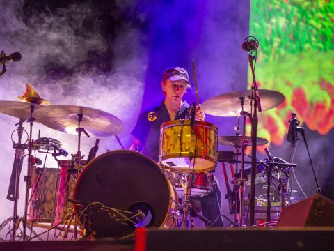 Modest Mouse drummer Jeremiah Green performs with the band on the Downtown Stage during day two ...