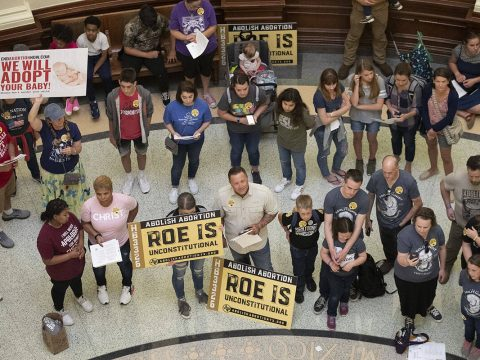 In this March 30, 2021, file photo, pro-life demonstrators gather in the rotunda at the Capitol ...