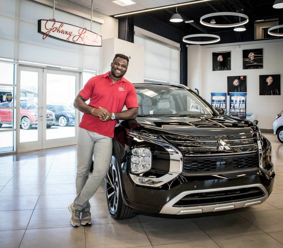 UFC Heavyweight Champion Francis Ngannou stands in front of the 2022 Outlander at Johnny Legend ...