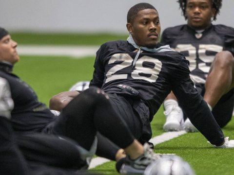 Raiders running back Josh Jacobs (28) stretches during team practice at the Raiders Headquarter ...