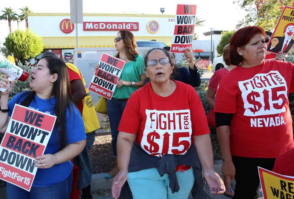 McDonald's franchise employees, including Diana Diaz, center, and Lupe Guzman, right, protest f ...