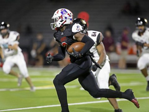 Liberty High School's Germie Bernard (2), center, runs into the end zone for a touchdown during ...