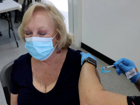 Algene Evans Wucinich of Las Vegas gets a Pfizer COVID-19 vaccine booster shot at the Southern ...