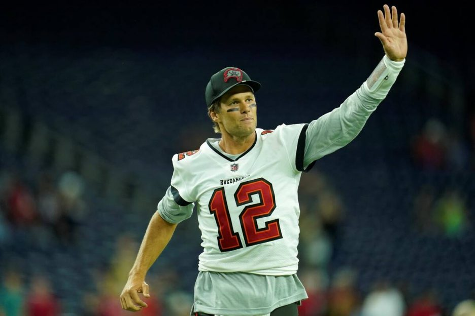Tampa Bay Buccaneers quarterback Tom Brady (12) waves toward the fans as he leaves the field af ...
