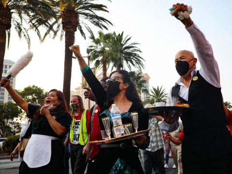 Nympha Comacchio, from left, Cristina Kline, center, and Jose Rivera, right, chant as they marc ...