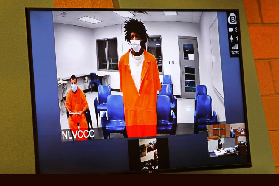 Andre Robinson appears via video conference during a court hearing at North Las Vegas Justice C ...