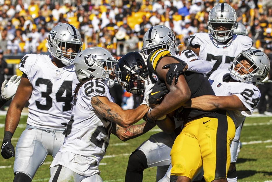 Raiders defensive back Johnathan Abram (24), Raiders safety Trevon Moehrig (25) and Raiders out ...