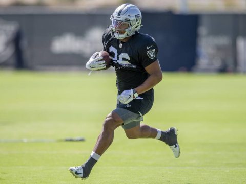Raiders running back Trey Ragas (36) runs with the football during team practice at the Raiders ...