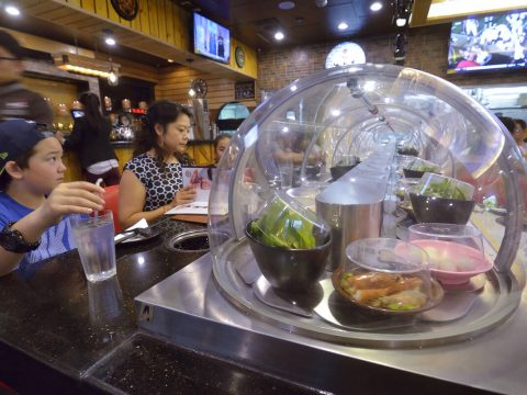 A conveyor belt brings food directly to diners at the Chubby Cattle restaurant. (rjmagazine)