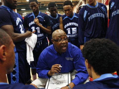 Canyon Springs head coach Freddie Banks talks to his team during a time-out against Valley High ...