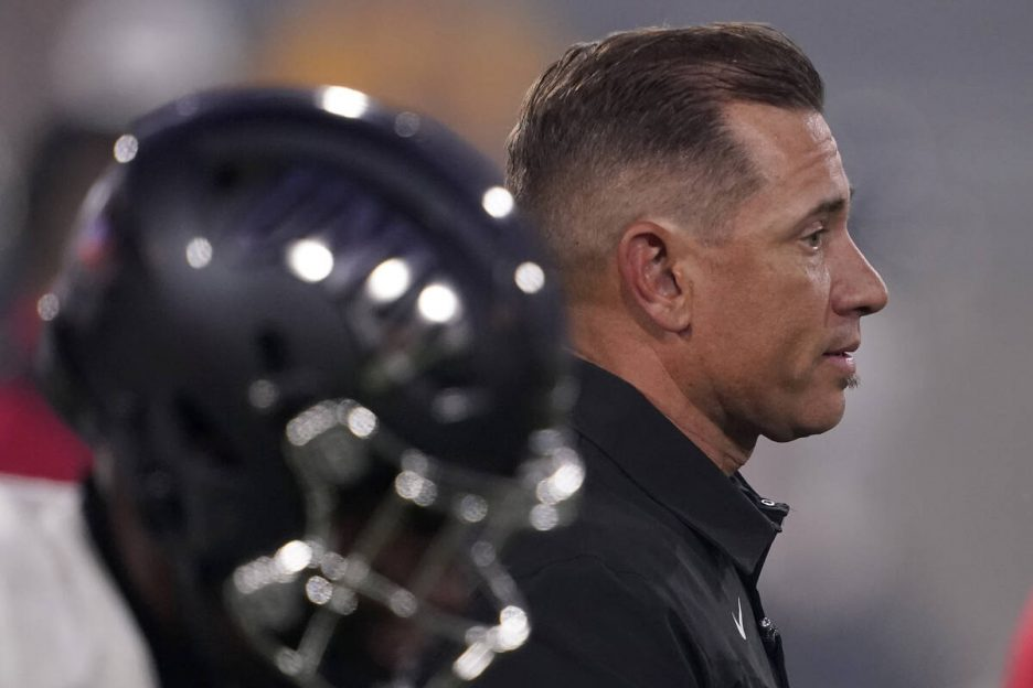 UNLV head coach Marcus Arroyo watches his team prior to an NCAA college football game against A ...