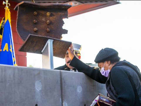 Carolann Roberts of Henderson prays while touching a piece of World Trade Tower steel on displa ...