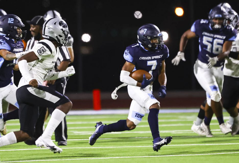Canyon Springs running back Kenneth Jacobs (7) runs the ball against Palo Verde during the firs ...