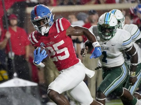 Mississippi running back Henry Parrish Jr. (25) runs past Tulane defenders on his way to a 19-y ...
