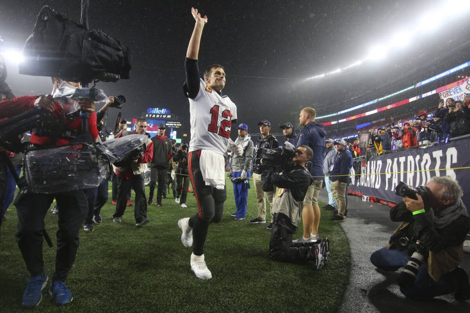 Tampa Bay Buccaneers quarterback Tom Brady (12) waves to the fans as he runs off the field foll ...