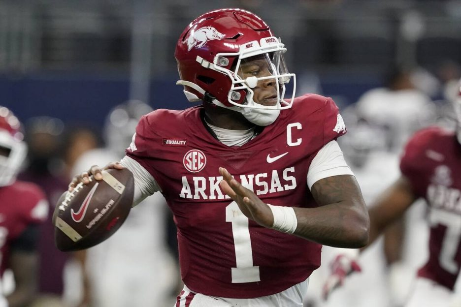 Arkansas quarterback KJ Jefferson (1) rolls out of the pocket before throwing a pass during an ...