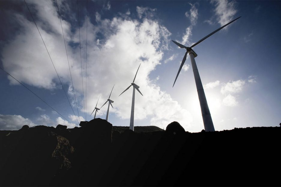 Wind turbine and wind swept surrounding plants and terrain of the 45th Operations Group Detachm ...