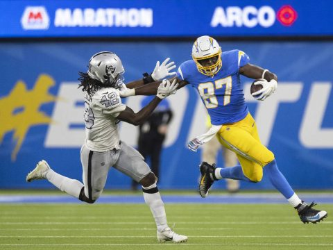 Los Angeles Chargers tight end Jared Cook (87) stiff arms Raiders inside linebacker Cory Little ...