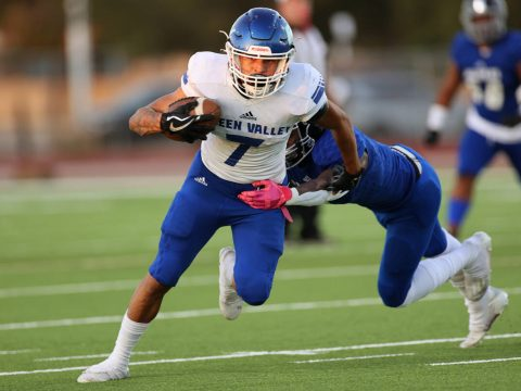 Green Valley's Anton Keeling (7) dodges a tackle by Desert Pines' Tyree Beasley (1) in the firs ...