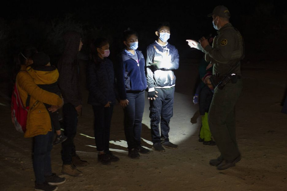 FILE - In this March 28, 2021 file photo Migrants from Guatemala and Honduras are questioned by ...