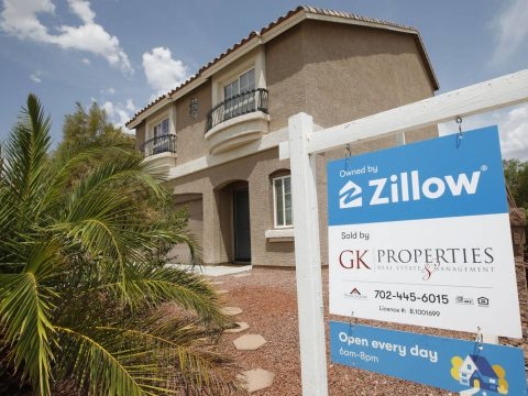 A sale sign is seen in front of a Zillow-owned house at 9992 Mills Reef Court in Las Vegas, Fri ...