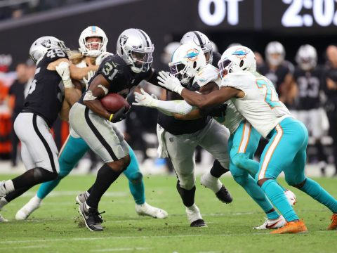 Las Vegas Raiders running back Peyton Barber (31) runs the ball in overtime in a NFL football g ...