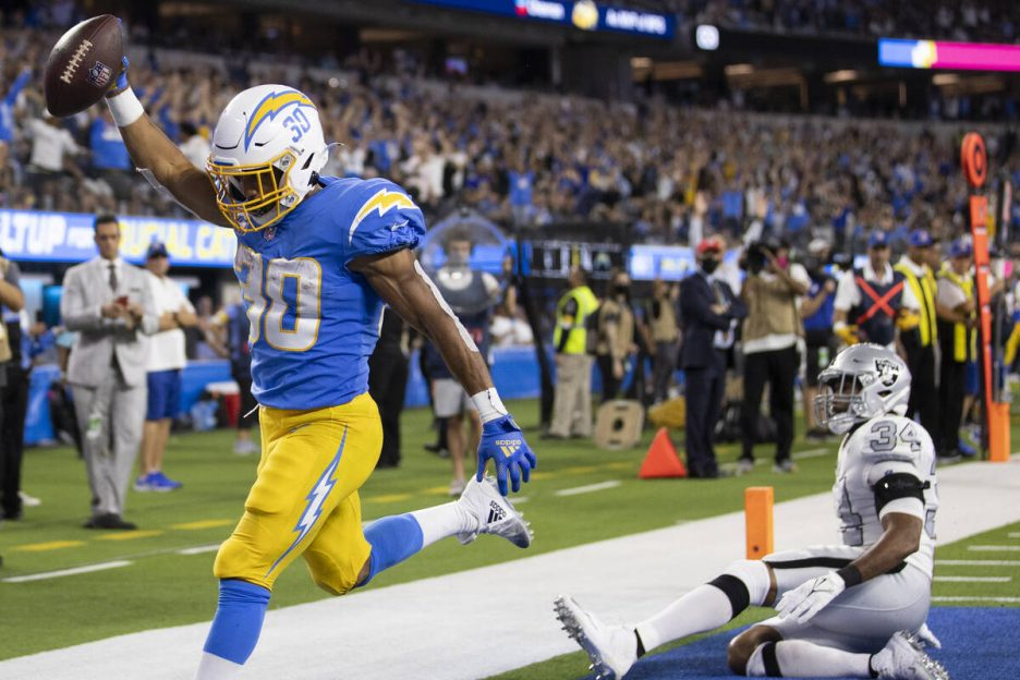 Los Angeles Chargers running back Austin Ekeler (30) scores a touchdown past Raiders outside li ...