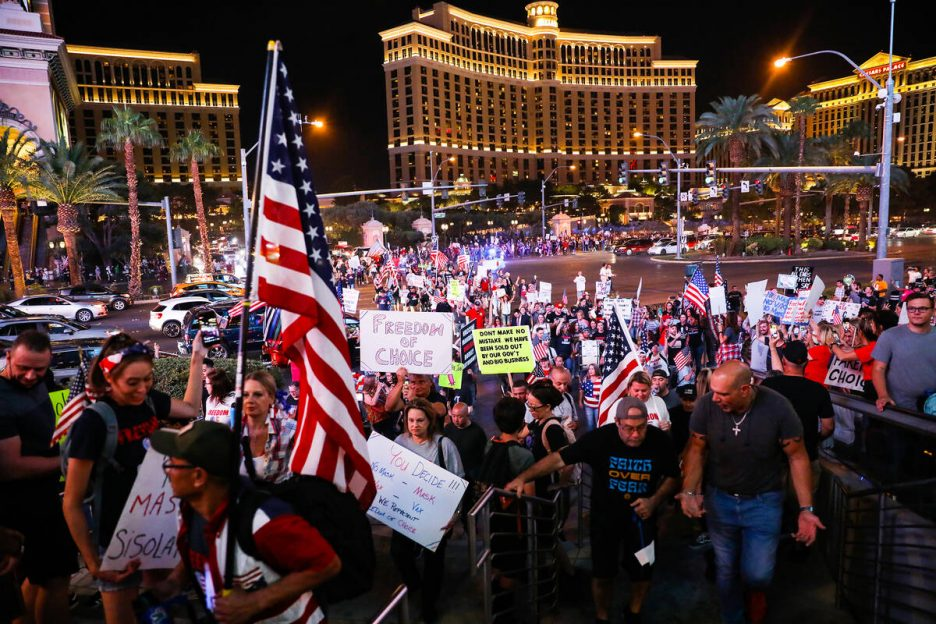 Protestors walk the Strip to protest COVID-19 government mandates, hosted by the non-profit Fre ...