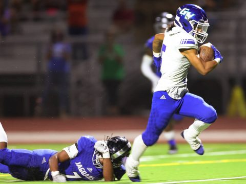 Green Valley's Freddy Rodriguez (5) runs for a touchdown as Desert Pines' Omar Ali (7) misses a ...