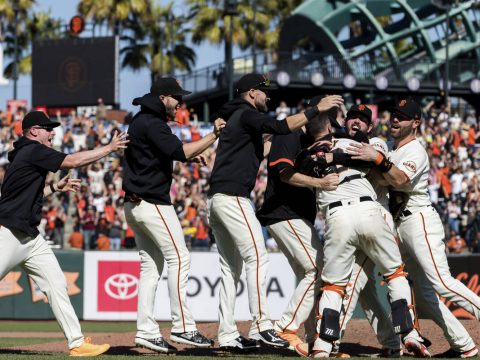 The San Francisco Giants celebrate after defeating the San Diego Padres in a baseball game in S ...