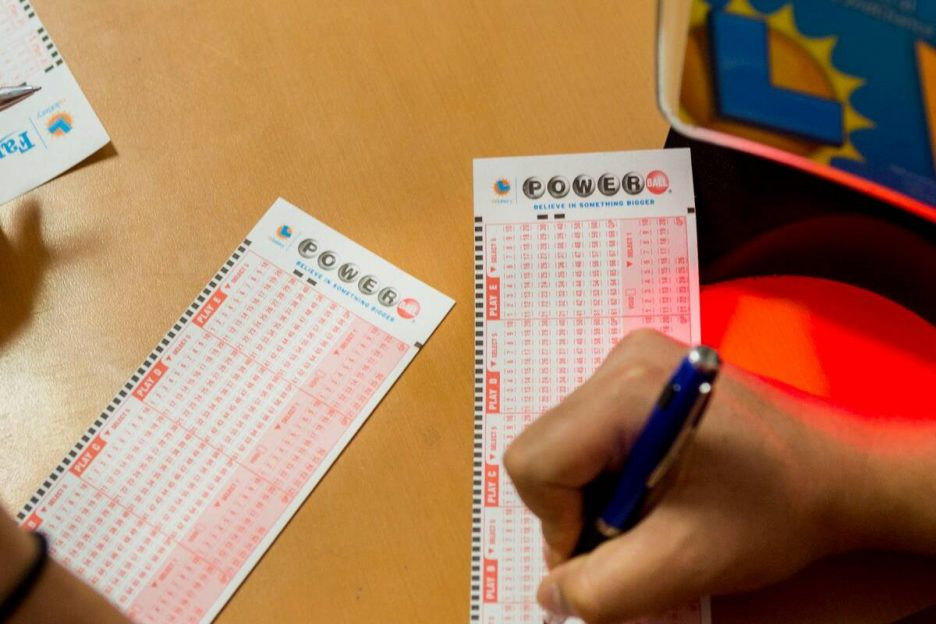 People fill out their numbers on a Powerball ticket at the Primm Valley Lotto Store in August 2 ...