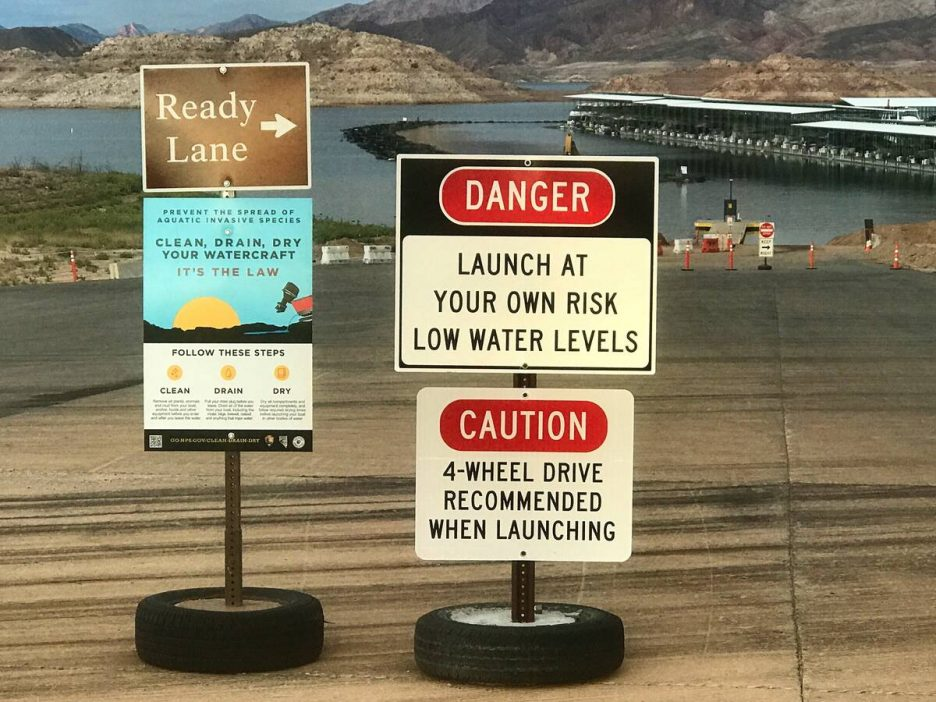 Signs warning of low-water conditions greet boaters at the Hemenway Harbor Launch Ramp at the L ...