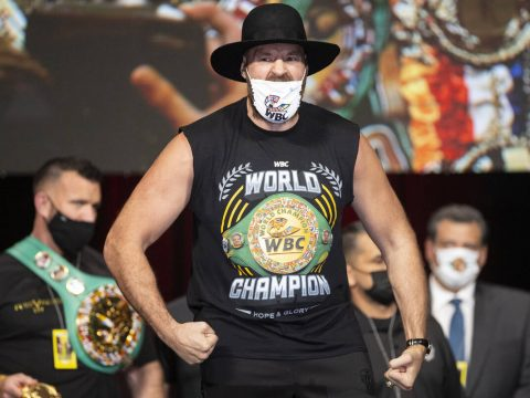 Tyson Fury poses during a weigh-in event at the MGM Grand Garden Arena in Las Vegas, Friday, Oc ...