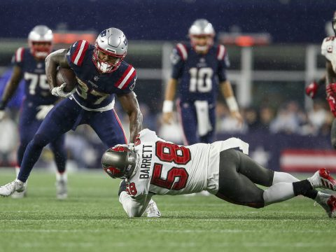 New England Patriots running back Damien Harris (37) is tackled by Tampa Bay Buccaneers linebac ...